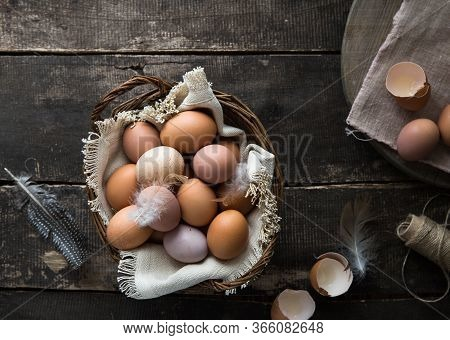 Egg. Basket Of Homemade Eggs On Wooden Table . Top View