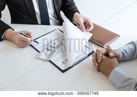 Businessman Giving Bribe Money In The Envelope Of Their Partner To Give Success The Deal Contract In