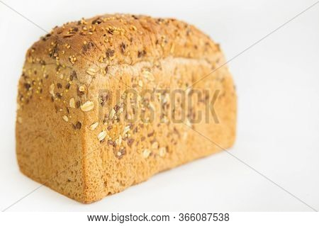 Homemade Tasty Brick Form Bread. Crusty Whole Loaf With Cereals, Oats, Seeds Isolated On White Backg