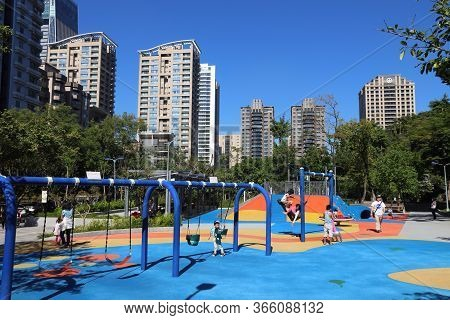 Taipei, Taiwan - December 3, 2018: People Visit Playground At A Public Park In Xinyi District Of Tai