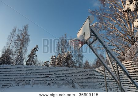 A Snow Covered Basketball Court
