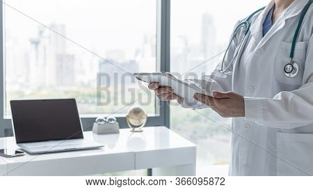 Telemedicine By Medical Doctor Or Physician Consulting Patient's Health Telehealth Online Using Mobi