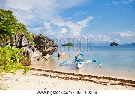 Beautiful Seascape With A Boat. Rocks By The Sea On Caramoan Island, Philippines, Asia. Beautiful Se