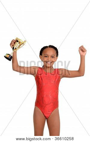 Young girl with gymnastics trophy