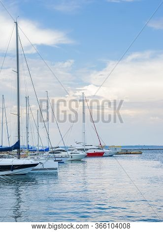 Marine Landscape With A Lot Of Luxury Boats And Yachts At Sunset Moored At Pier. Summer Holidays Und