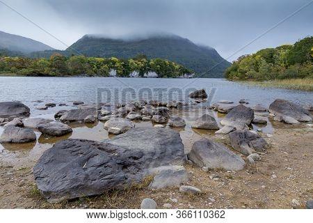 An Irish Lake In The Rugged Countryside