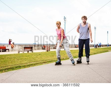 Outdoors Activities Sport And Free Time. Summertime Exercising And Healthy Body. Young Couple Have F