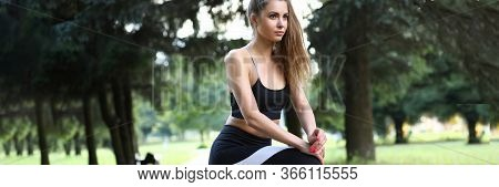 Beautiful Girl In Sportswear Flexes Muscles Feet. Nervous System Calms Down Through Outdoor Exercise