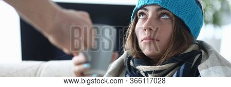 Close-up Of Sickness Lady Treated And Taking Medication. Tired Ill Wife Taking Cup Of Medicine From