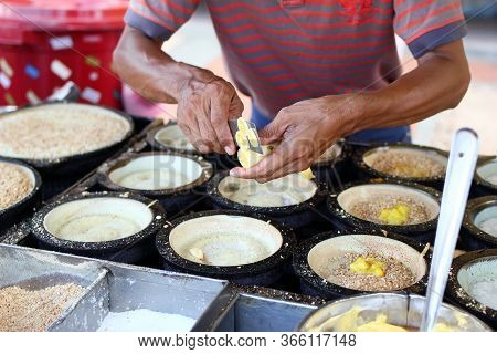 Unrecognizable Man Is Cooking Traditional Malaysian Street Food Apam Balik - Thick Soft Pancake With