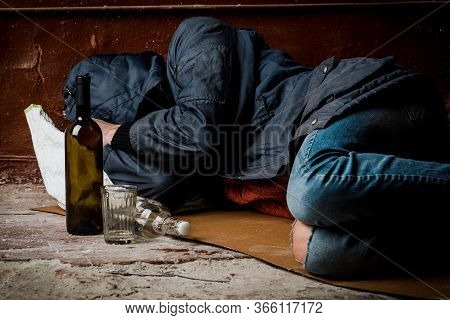A Homeless Man, A Drunk, Fell Asleep On The Street. The Concept Of Alcoholism And Homelessness.