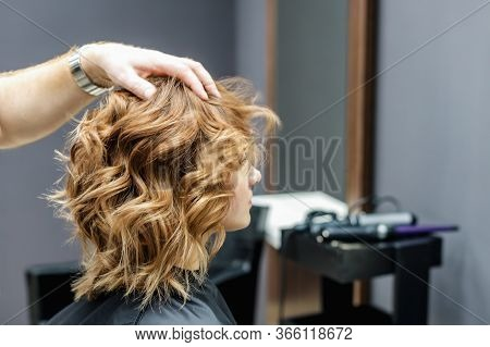 Female Hairdresser Checking Womans Hairstyle In Beauty Salon, Close Up.