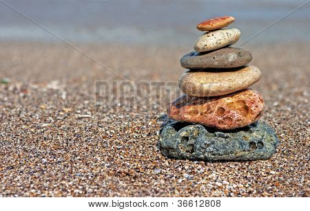 Stack Of Balanced Stones On The Beach