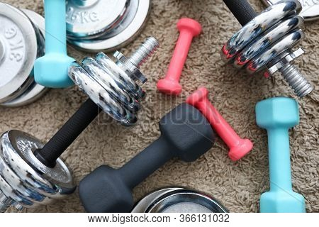 Pile Of Shiny Chrome Dumbbells Disks Lying Around Grip At Home Rug As Domestic Sport Exercises Durin