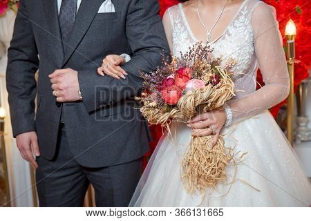 The Bride Entered The Grooms Armpit And Held A Bouquet Of Flowers . Dried Coral Reach Pink Wheat Cot