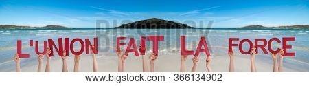 Hands Holding La Union Fait La Force Means Stronger Together, Ocean Background