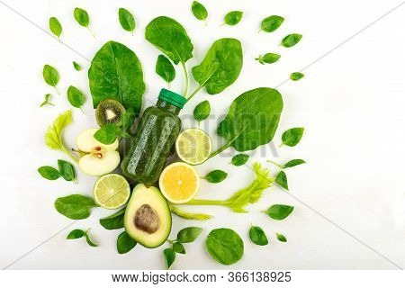 A Creative Composition Of Several Bottles Of Green Smoothies On A White Background In The Occlusion