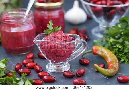 Homemade Dogwood Sauce In Sauceboat And Glass Jars On Dark Background, Tkemali Sauce