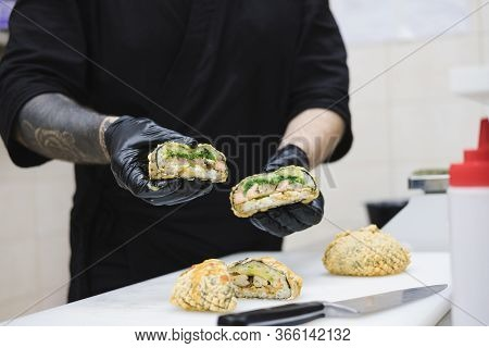 Deep Fried Sushi Burgers In Chef's Hands. Takeaway Food, Fastfood Kitchen: Cook In The Commercial Ki