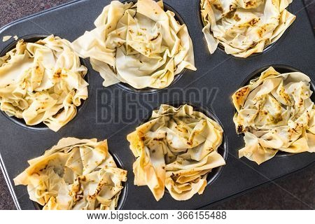 Plant-based Food, Filo Pastry Cups With Vegan Filling In Muffin Tray Just Out Of The Oven