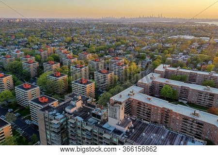 Aerial View Of Queens In New York City At Sunset With The George Washington Bridge In The Background