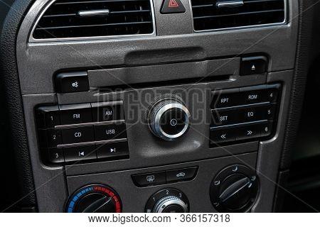 Novosibirsk/ Russia - May 03 2020: Brilliance V5, Car Dashboard Audio In Fm-receiver, Cd, Volume Con