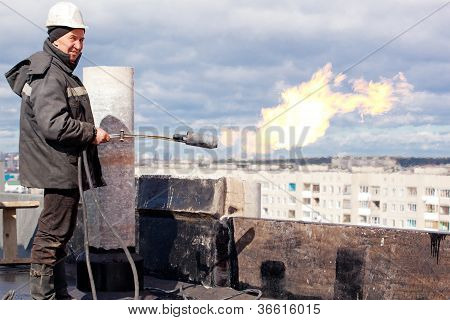 Positive roofer with a gas torch