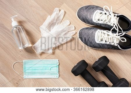 protective medical mask sanitizer gel gloves. home fitness training sneakers dumbbell and protective measures against virus, bacteria