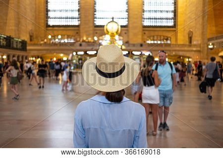 Young tourist wearing a hat at the Grant Central Terminal, NYC. USA 2019