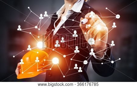 Businesswoman With Abstract Social Network Interaction Structure. Woman In Business Suit Holding Saf