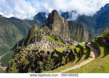 Terraces In The Ancient City Of Machu Picchu, Peru. Cloudy Sky