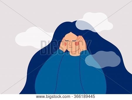 The Sad Woman Touches Her Temples With Her Hands And Suffers From A Headache. A Depressed Girl Suffe