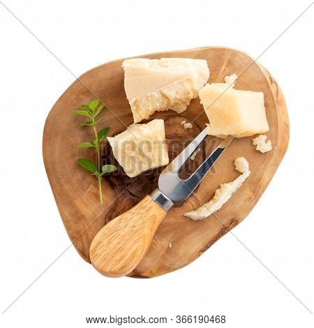 Piece Of Parmesan Cheese On Wooden Board  Isolated On White. Parmigiano Reggiano, Hard Mature Cheese
