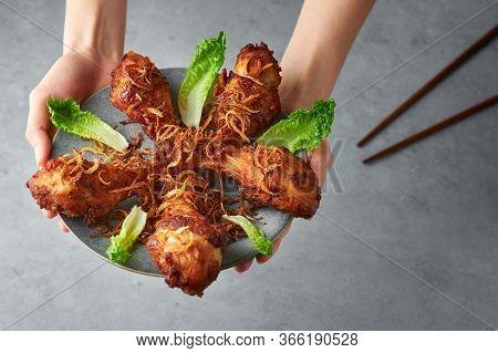 Gai Tod Hat Yai Or Thai Deep Fried Chicken On Gray Plate On Concrete Background. Gai Tod Had Yai Is