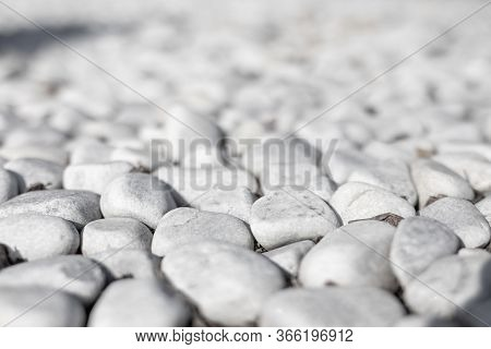 White Pebbles Stone Texture And Background. Artistic Closeup View Of White Pebbles Infinity Blurred