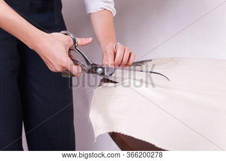 Seamstress Cuts Fabric With Tailor's Scissors. Leasure Activity