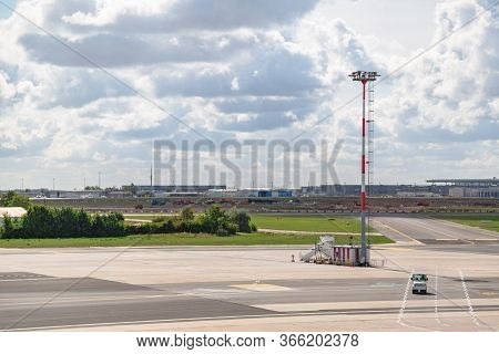 Empty Airfield With Control Tower And Company Car