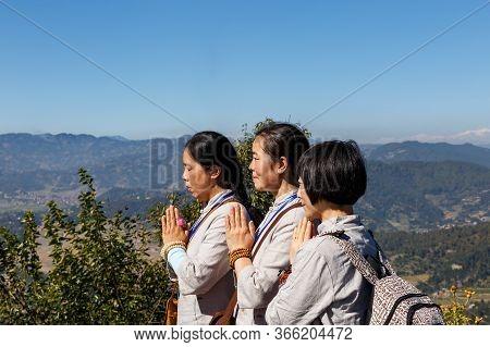 Simalchaur Syampati, Nepal - November 15, 2016: Three Women Pray Near Chorten At Namobuddha. Namo Bu