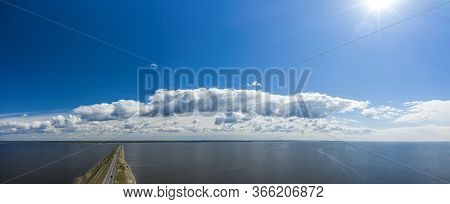 Aerial View Of The Amazing Big River With Dam Under Beautiful Cloudy Blue Sky. Europe, Ukraine, Krem