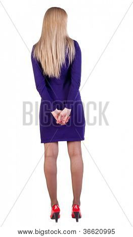 back view of standing beautiful blonde with long hair business woman. Young girl in violet dress. Rear view people collection. backside view of person. Isolated over white background.
