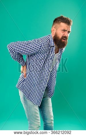 Bent Over Feeling Sharp Pain In Back. Bearded Man Suffer From Pain Shoots. Back Posture. Back Bone.