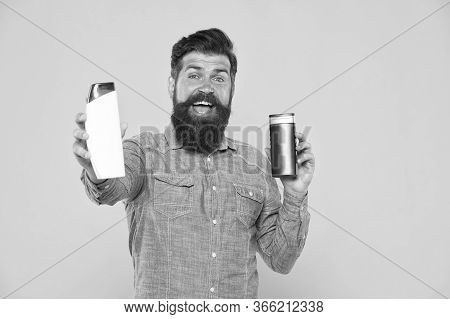Good Choice. Happy Hipster Hold Shampoo And Conditioner Yellow Background. Brutal Hipster With Hair