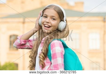 Child Headphones Listen Music. Audio Book Concept. Studying Audio Lessons. Listen Music While Walkin