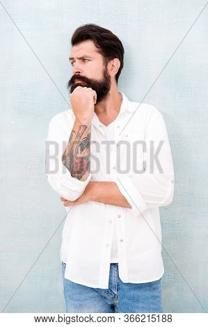 Sexy Model Posing. Bearded Man Wear White Shirt. Male Casual Fashion. Summer Collection. Thoughtful
