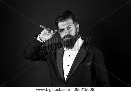 Self Care Isnt Selfish. Businessman Keep Razor At Unshaven Face. Bearded Man Hold Sharp Blade. Beard