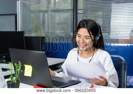 Happy Asian Young Businesswoman Or University Student Reading Documents Reports Papers, Entrepreneur