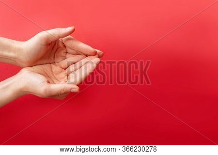 Folded Hands. Womens Hands Folded In Prayer On A Red Background