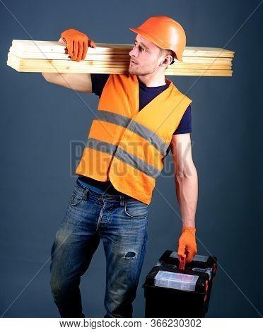 Carpenter, Woodworker, Labourer, Builder On Busy Face Carries Wooden Beams On Shoulder. Woodcraft Co