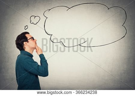 Side View Businessman Keeps Hand Under Chin, Thoughtful Gesture. Business Person Wears Glasses Looki