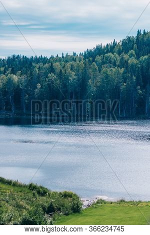Beautiful Lake With Scenic Forest On A Bright Sunny Summer Day